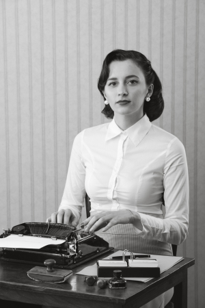 Retro business woman typing in her office Stock Photo - 18530474