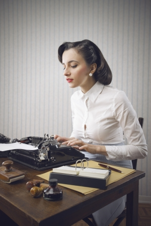 typewriter: Retro business woman typing in her office