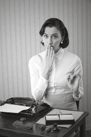 Retro office worker with surprised expression photo