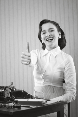 Smiling office worker showing thumb up Stock Photo - 18530475