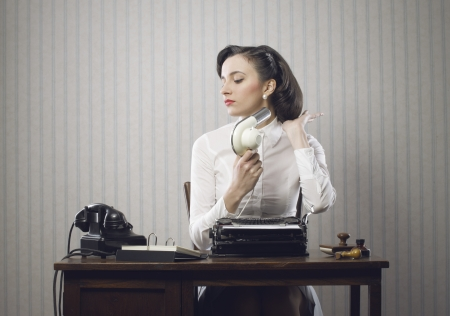 Business woman drying her hair in office Stock Photo - 18530529