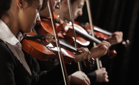 Symphony music, violinists at concert photo