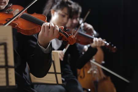 Symphony music, violinist at concert, hand close up Stock Photo - 18734413