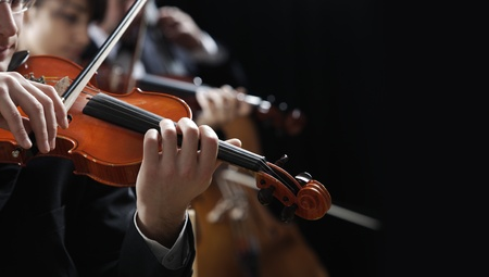 Symphony music, violinist at concert, hand close up photo