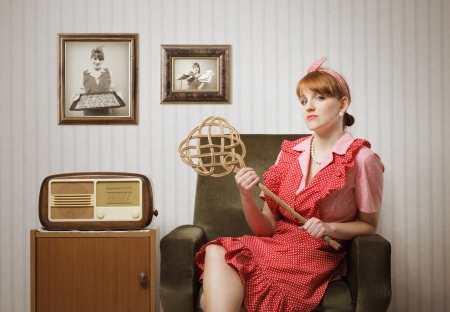 short sleeved: Ironic portrait of a housewife retro sitting in an armchair