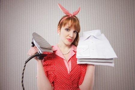 retro housewife with iron and ironed shirts Stock Photo - 18628478