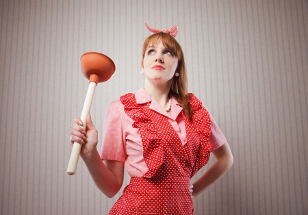 house maid: Retro housewife with tool to clean toilettes