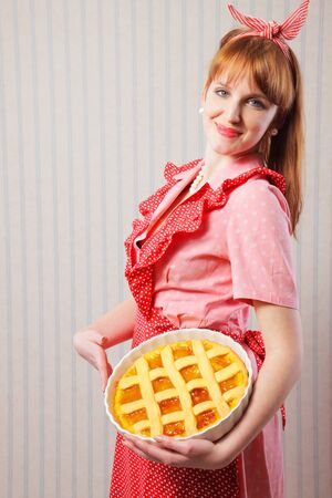 Retro housewife holding hot italian pie. Stock Photo - 18628509