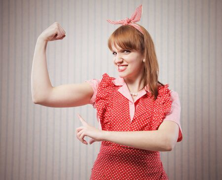 Strong woman housewife showing muscular strength Stock Photo - 18628506