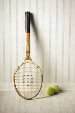 tenniss racket and balls against a vintage wallpaper Stock Photo - 18654256