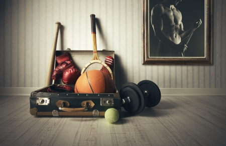 Old Suitcase with sports equipment and athlete photo photo