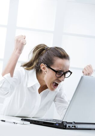 freaked: Freaked out businesswoman ready to smash her laptop computer