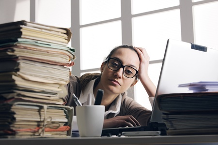 tons: Young tired businesswoman with tons of documents