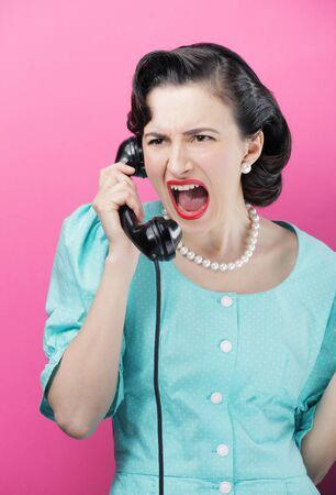retro phone: Vintage Woman shouting into telephone Stock Photo