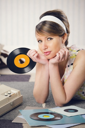 turntables: Beautiful woman listening to a record