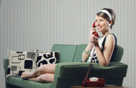 Attractive young woman on couch  talking on the phone Stock Photo - 19167030