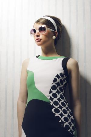 Portrait of woman with retro sunglasses. 1960 style photo