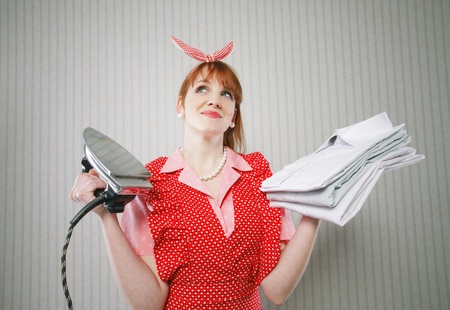 Perfect housewife with iron and ironed shirts Stock Photo - 19167077