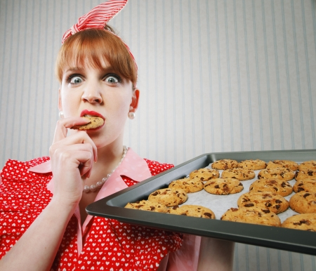 Retro housewife sneaking cookies photo