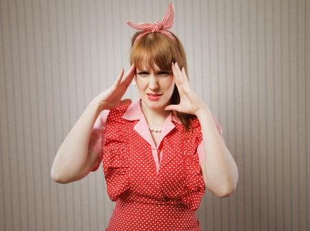 short sleeved: Retro housewife suffering headache Stock Photo