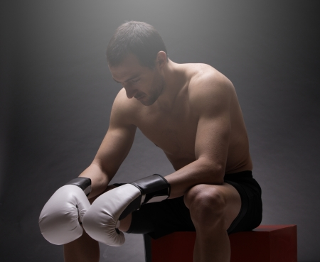 builds: Boxer man concentrating on dark background Stock Photo