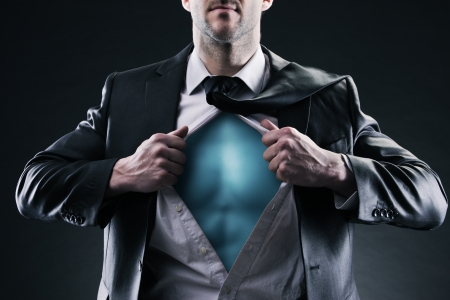 alter ego: Superhero businessman pulls open shirt. Change and success concept.