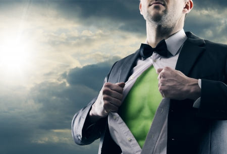 alter ego: Superhero businessman pulls open shirt. Green Power