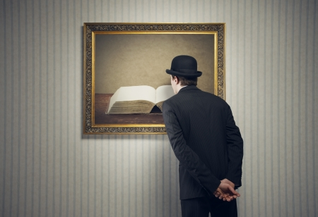 art gallery: Elegant man looking at a book with blank pages Stock Photo