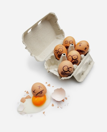Eggs in a box are scared of dead friend Stock Photo - 19148805