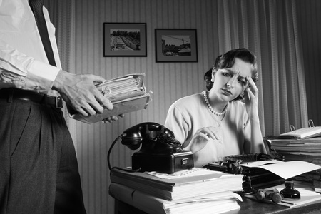 old office: Stressed businesswoman with a too much paperwork and documents Stock Photo