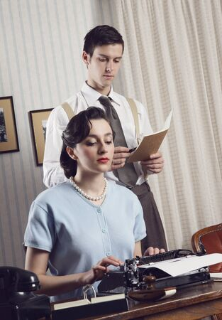 Business partners working in an office, vintage style photo