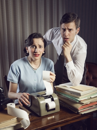 Scared man and woman looking at their bills in the living-room at home Stock Photo - 19287314