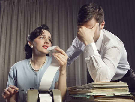 Stressed man and woman looking at their bills in the living-room at home Stock Photo - 19287297