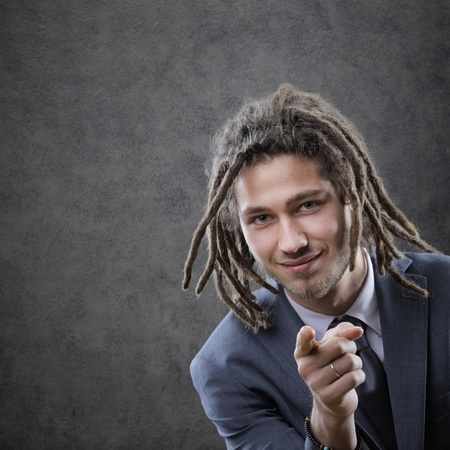 dreadlock: Young business man in suite, pointing at camera