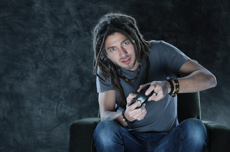 Young man playing Videogames photo