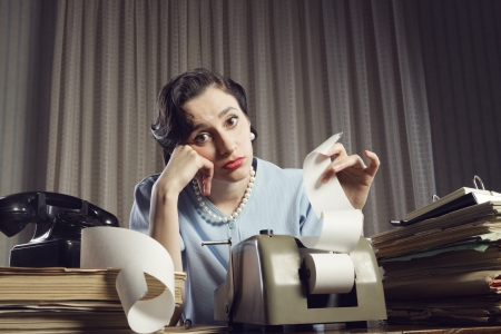 An female accountant going over figures and very upset by the result. Stock Photo - 19387276