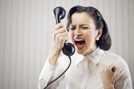 angry face: Angry Business Woman shouting into telephone