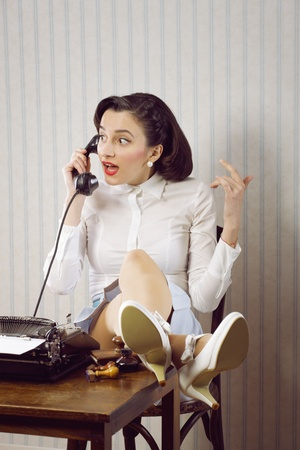 rumor: Gossip news, business woman talking on phone at desk