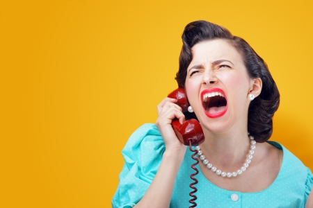 Vintage Woman shouting into telephone Stock Photo