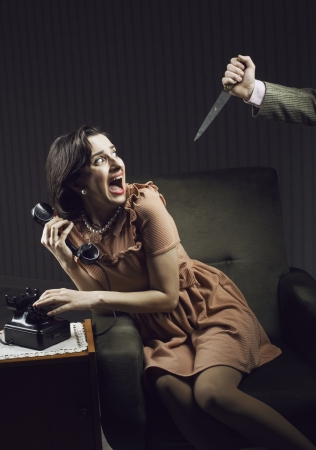 fear face: Terrified woman by a man murderess with a knife
