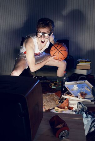 Nerdy excited basketball fans watching television photo