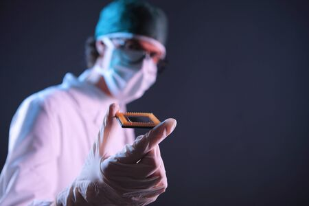 Computer engineer examining a microchip cpu Stock Photo - 19432992