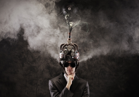 coercive: Business man wearing a brain-control helmet, forced ideas extraction