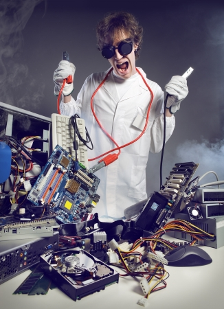 Crazy computer technician is trying to repair a computer Stock Photo - 19433050