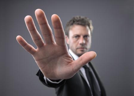 injunction: Businessman in a suit, gesturing stop