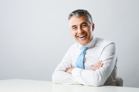 and the horizontal man: Portrait of a handsome mature man smiling Stock Photo