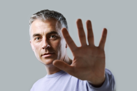 injunction: Portrait of casual man  gesturing stop