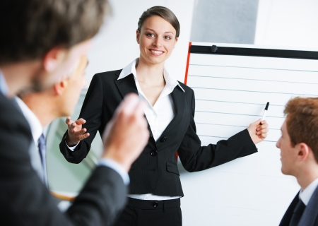 businessowman: Confident businessowman giving a presentation on whiteboard Stock Photo