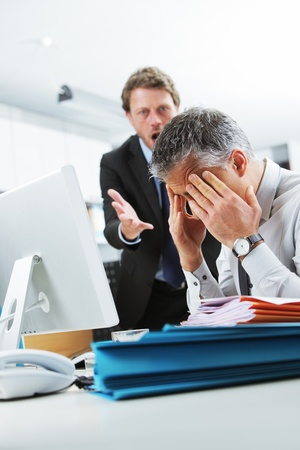 Mature manager shouting at his office worker Stock Photo - 19844697