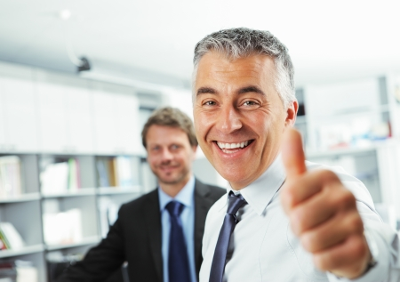 good looking man: Happy businessman showing thumbs up sign